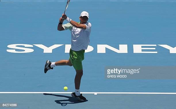 Novak Djokovic of Serbia plays a backhand return against Paul-Henri Mathieu of France during the Sydney International tennis tournament on January...
