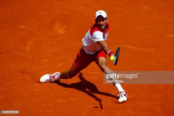 Novak Djokovic of Serbia plays a backhand return during his Mens Singles match against Borna Coric of Croatia at MonteCarlo Sporting Club on April 18...