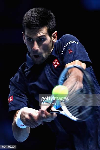 Novak Djokovic of Serbia plays a backhand shot during his men's singles semi final against Kei Nishikori of Japan on day seven of the ATP World Tour...