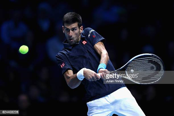 Novak Djokovic of Serbia plays a backhand shot during his men's singles semi final against Kei Nishikori of Japan on day seven of the ATP World Tour...