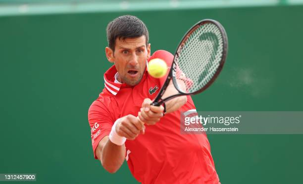 Novak Djokovic of Serbia plays a backhand shot during their Round 32 match against Jannik Sinner of Italy during day four of the Rolex Monte-Carlo...