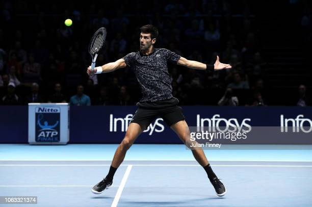 Novak Djokovic of Serbia plays a backhand volley in the final against Alexander Zverev of Germany during Day Eight of the Nitto ATP Finals at The O2...