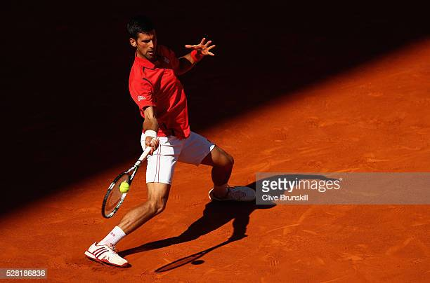 Novak Djokovic of Serbia plays a forehand against Borna Coric of Croatia in their second round match during day five of the Mutua Madrid Open tennis...