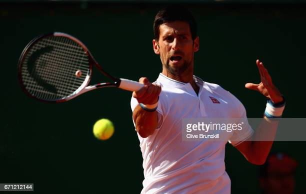 Novak Djokovic of Serbia plays a forehand against David Goffin of Belgium in their quarter final round match on day six of the Monte Carlo Rolex...