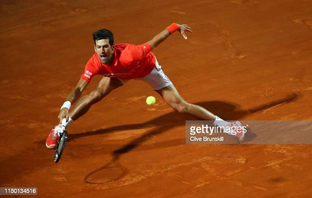 Novak Djokovic of Serbia plays a forehand against Diego Schwartzman of Argentina in their semifinal match during day seven of the International BNL...