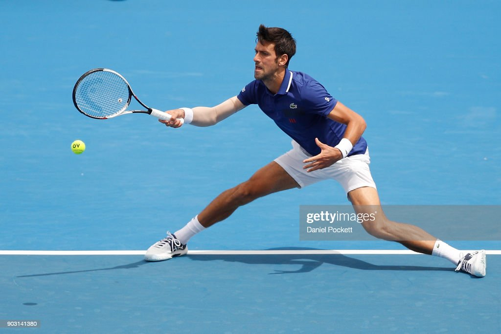 Novak Djokovic of Serbia plays a forehand against Dominic Thiem of Austria in the 2018 Kooyong Classic at Kooyong on January 10, 2018 in Melbourne, Australia.