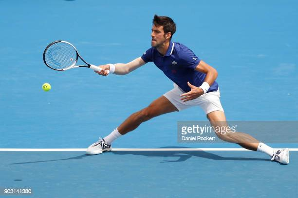 Novak Djokovic of Serbia plays a forehand against Dominic Thiem of Austria in the 2018 Kooyong Classic at Kooyong on January 10 2018 in Melbourne...