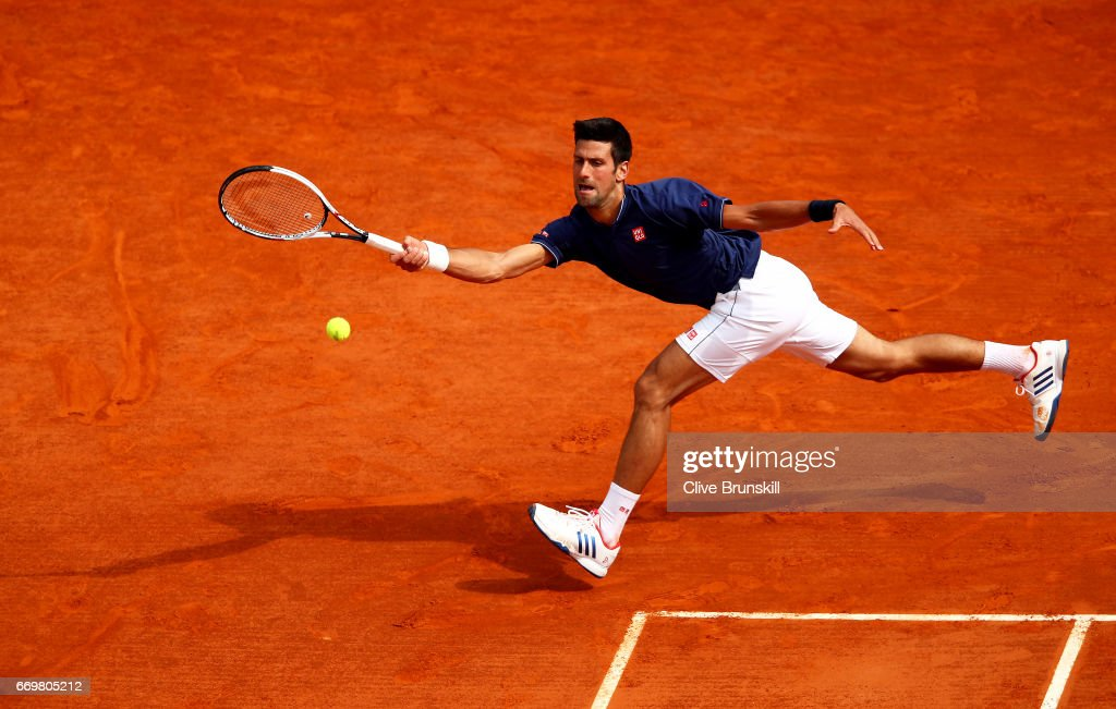 Novak Djokovic of Serbia plays a forehand against Gilles Simon of France in his second round match on day three of the Monte Carlo Rolex Masters at Monte-Carlo Sporting Club on April 18, 2017 in Monte-Carlo, Monaco.