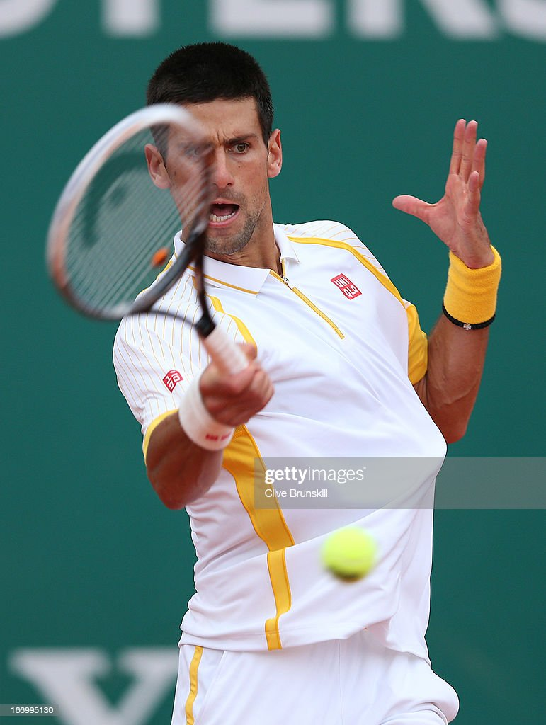 Novak Djokovic of Serbia plays a forehand against Jarkko Nieminen of Finland in their quarter final match during day six of the ATP Monte Carlo Masters, at Monte-Carlo Sporting Club on April 19, 2013 in Monte-Carlo, Monaco.