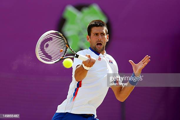 Novak Djokovic of Serbia plays a forehand against Juan Martin Del Potro of Argentina during the Men's Singles Tennis Bronze Medal Match on Day 9 of...
