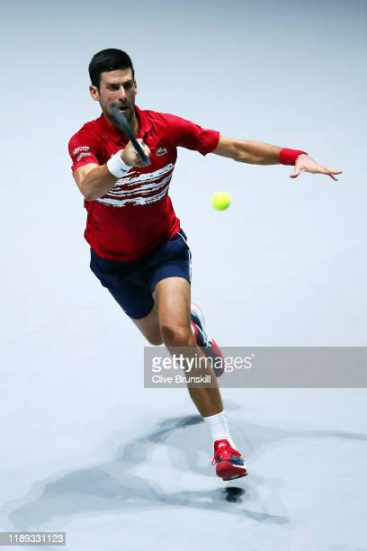 Novak Djokovic of Serbia plays a forehand against Karen Khachanov of Russia during his quarter final singles match on Day Five of the 2019 David Cup...
