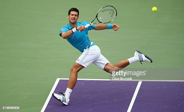 Novak Djokovic of Serbia plays a forehand against Kei Nishikori of Japan in the mens final during the Miami Open Presented by Itau at Crandon Park...