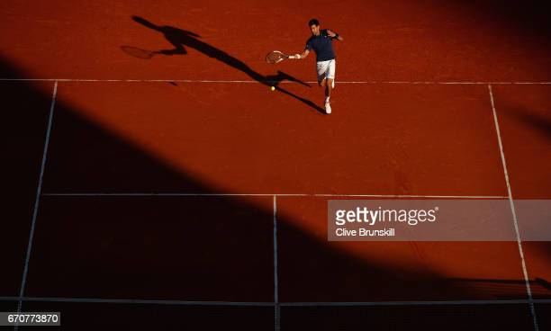 Novak Djokovic of Serbia plays a forehand against Pablo Carreno Busta of Spain in his third round match on day five of the Monte Carlo Rolex Masters...