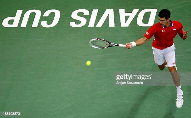 Novak Djokovic of Serbia plays a forehand against Radek Stepanek of Czech Republic during the day one of the final Davis Cup match between Serbia and...