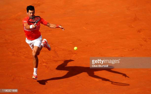 Novak Djokovic of Serbia plays a forehand against Rafael Nadal of Spain in the mens final during day eight of the International BNL d'Italia at Foro...