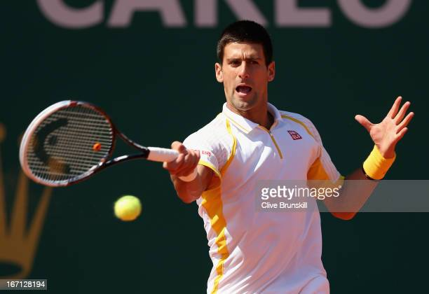 Novak Djokovic of Serbia plays a forehand against Rafael Nadal of Spain in their final match during day eight of the ATP Monte Carlo Masters,at...