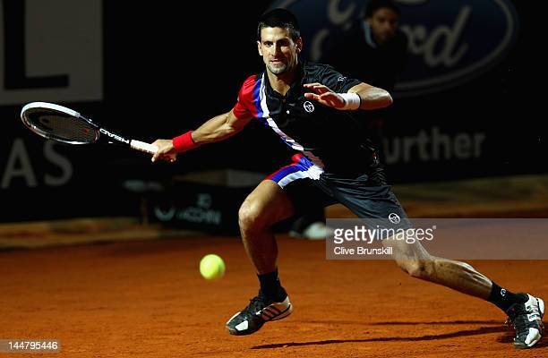 Novak Djokovic of Serbia plays a forehand against Roger Federer of Switzerland in their semi final match during day eight of the Internazionali BNL...