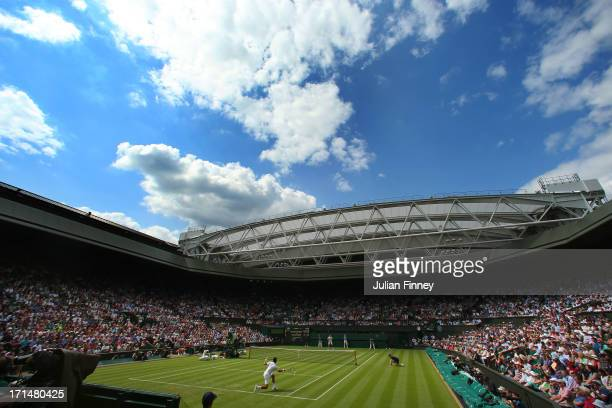 Novak Djokovic of Serbia plays a forehand during his Gentlemen's Singles first round match against Florian Mayer of Germany on Centre Court during...