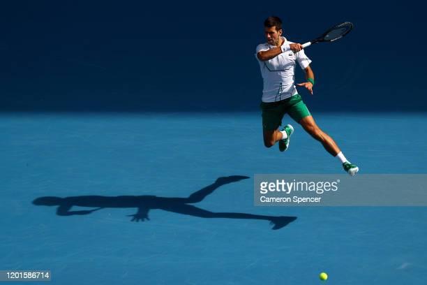 Novak Djokovic of Serbia plays a forehand during his Men's Singles third round match against Yoshihito Nishioka of Japan on day five of the 2020...