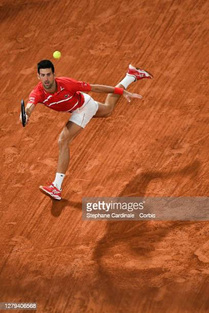 Novak Djokovic of Serbia plays a forehand during his Men's Singles semifinals match against Stefanos Tsitsipas of Greece on day thirteen of the 2020...