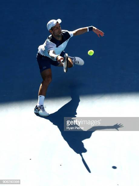 Novak Djokovic of Serbia plays a forehand during his second round match against Gael Monfils of France on day four of the 2018 Australian Open at...