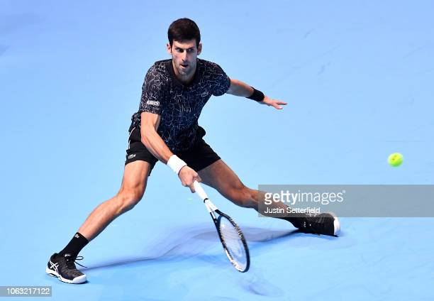 Novak Djokovic of Serbia plays a forehand during his singles final against Alexander Zverev of Germany during Day Eight of the Nitto ATP Finals at...
