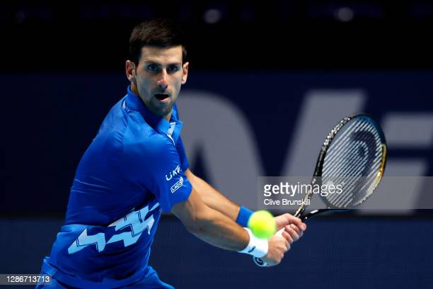 Novak Djokovic of Serbia plays a forehand during his singles match against Alexander Zverev of Germany during day six of the Nitto ATP World Tour...