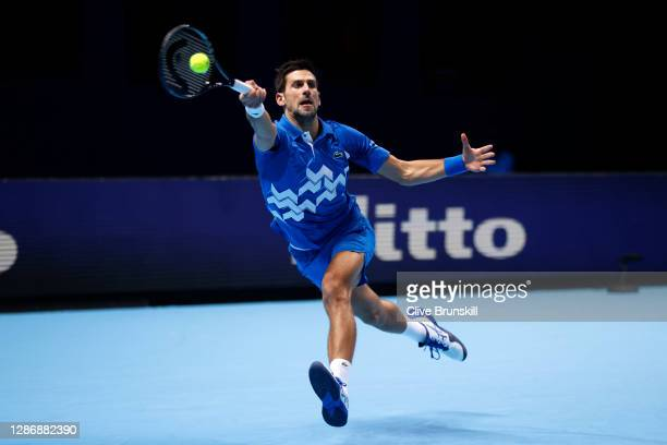 Novak Djokovic of Serbia plays a forehand during his singles semi final match against Dominic Thiem of Austria during day seven of the Nitto ATP...