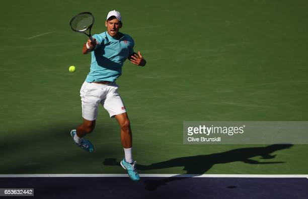Novak Djokovic of Serbia plays a forehand during his straight set defeat by Nick Kyrgios of Australia in their fourth round match during day ten of...