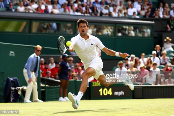 Novak Djokovic of Serbia plays a forehand during the Gentlemen's Singles first round match against Martin Klizan of Slovakia on day two of the...