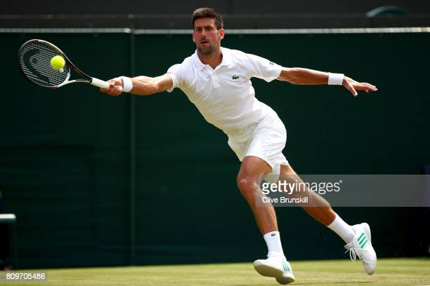 Novak Djokovic of Serbia plays a forehand during the Gentlemen's Singles second round match against Adam Pavlasek of the Czech Republic on day four...