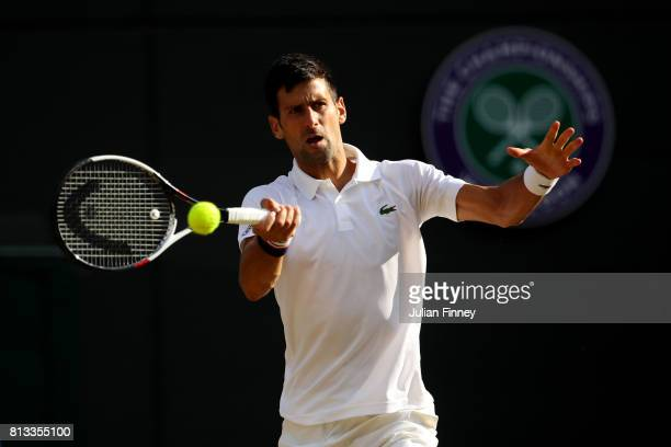 Novak Djokovic of Serbia plays a forehand during the Gentlemen's Singles quarter final match against Tomas Berdych of The Czech Republic on day nine...