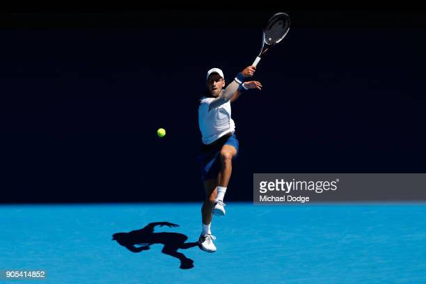 Novak Djokovic of Serbia plays a forehand in his first round match against Donald Young of the United States on day two of the 2018 Australian Open...