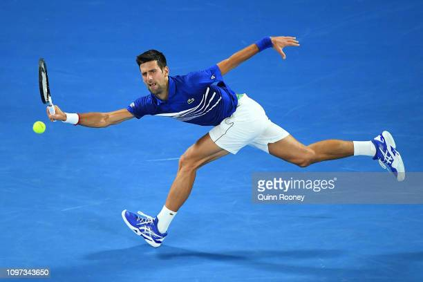Novak Djokovic of Serbia plays a forehand in his fourth round match against Daniil Medvedev of Russia during day eight of the 2019 Australian Open at...