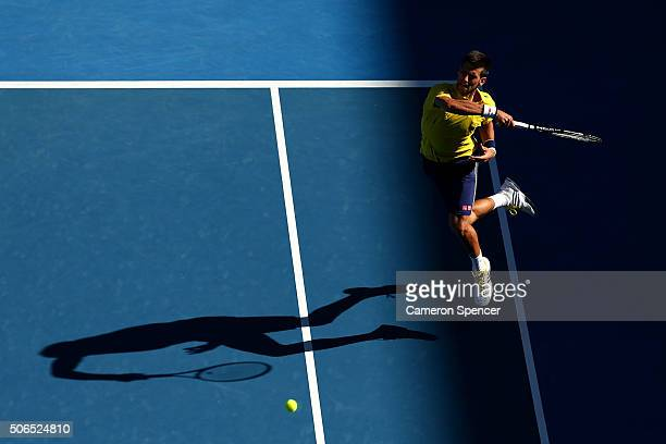Novak Djokovic of Serbia plays a forehand in his fourth round match against Gilles Simon of France during day seven of the 2016 Australian Open at...