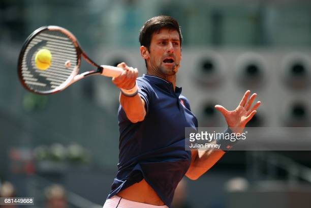 Novak Djokovic of Serbia plays a forehand in his match against Nicolas Almagro of Spain during day five of the Mutua Madrid Open tennis at La Caja...