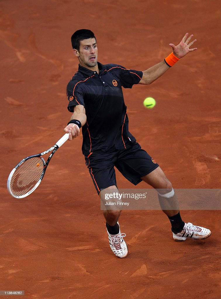 Novak Djokovic of Serbia plays a forehand in his match against Rafael Nadal of Spain in the final during day nine of the Mutua Madrilena Madrid Open Tennis on May 8, 2011 in Madrid, Spain.