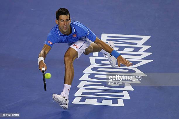 Novak Djokovic of Serbia plays a forehand in his men's final match against Andy Murray of Great Britain during day 14 of the 2015 Australian Open at...