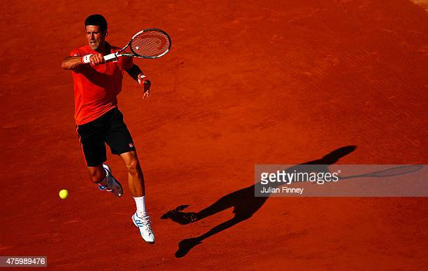 Novak Djokovic of Serbia plays a forehand in his Men's Semi Final match against Andy Murray of Great Britain on day thirteen of the 2015 French Open...