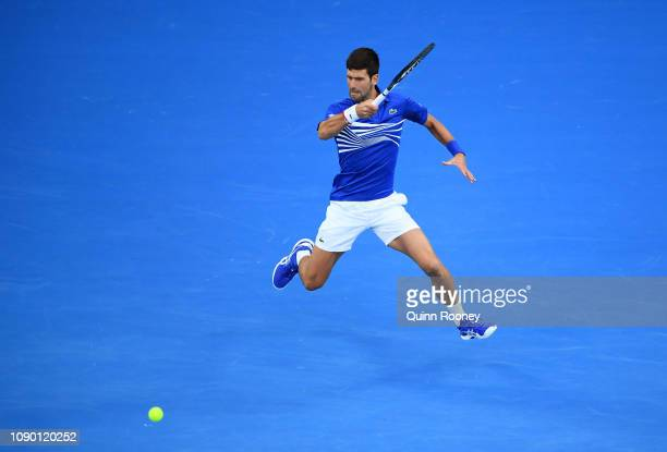 Novak Djokovic of Serbia plays a forehand in his Men's Singles Final match against Rafael Nadal of Spain during day 14 of the 2019 Australian Open at...