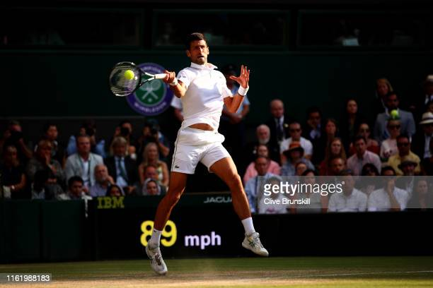 Novak Djokovic of Serbia plays a forehand in his Men's Singles final against Roger Federer of Switzerland during Day thirteen of The Championships...