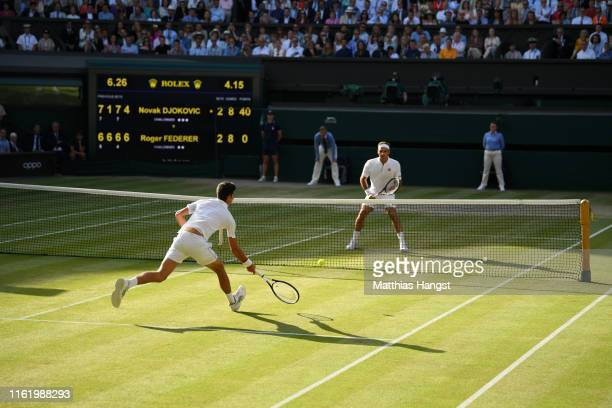 Novak Djokovic of Serbia plays a forehand in his Men's Singles final against Roger Federer of Switzerland during Day thirteen of The Championships -...