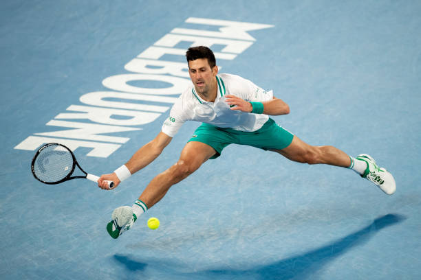 Novak Djokovic of Serbia plays a forehand in his Men's Singles Final match against Daniil Medvedev of Russia during day 14 of the 2021 Australian...