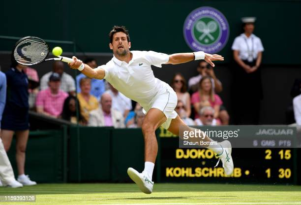 Novak Djokovic of Serbia plays a forehand in his Men's Singles first round match against Philipp Kohlschreiber of Germany during Day one of The...