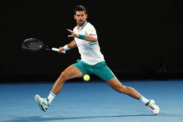 Novak Djokovic of Serbia plays a forehand in his Men's Singles fourth round match against Milos Raonic of Canada during day seven of the 2021...