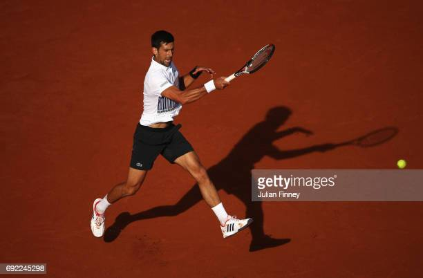 Novak Djokovic of Serbia plays a forehand in his men's singles fourth round match against Albert RamosVinolas of Spain during day eight of the French...