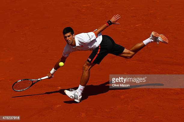 Novak Djokovic of Serbia plays a forehand in his Men's Singles match against Thanasi Kokkinakis of Australia on day seven of the 2015 French Open at...