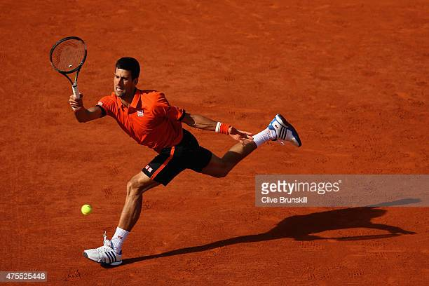 Novak Djokovic of Serbia plays a forehand in his Men's Singles match against Richard Gasquet of France on day nine of the 2015 French Open at Roland...