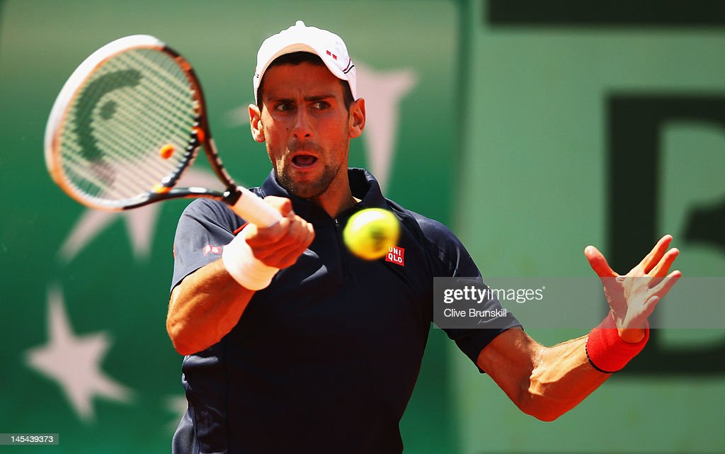 Novak Djokovic of Serbia plays a forehand in his men's singles second round match against Blaz Kavcic of Slovenia during day 4 of the French Open at Roland Garros on May 30, 2012 in Paris, France.