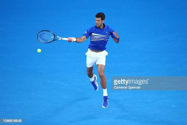 Novak Djokovic of Serbia plays a forehand in his quarter final match against Kei Nishikori of Japan during day 10 of the 2019 Australian Open at...
